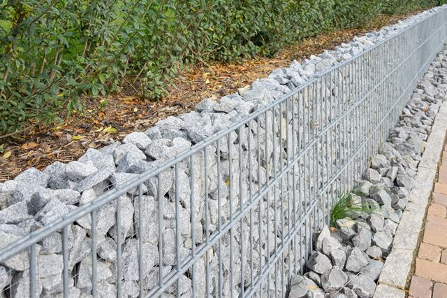 Tuinontwerp aanleg onderhoud kunstgras betonklinkers en afsluitingen de groenbroeders 29